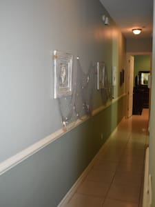 Hallway leading into master that shows no stairs
