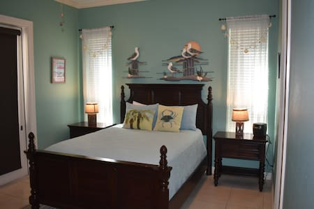 Master bedroom with space around bed