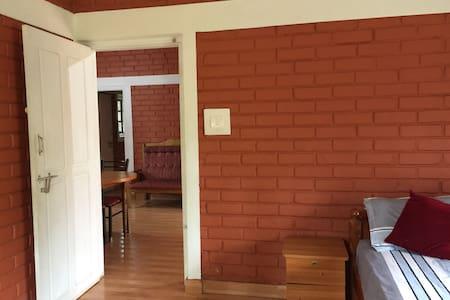 Wide pathway to Bedroom-1 Apple villa