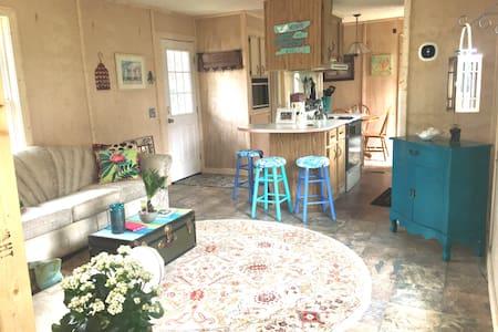 34 inch front door, 36 inch kitchen door.