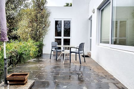 double french door leading to private patio. 3 steps to garden and pool