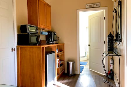 From kitchenette to bathroom is relatively flat.