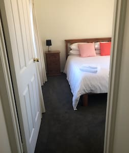 This bedroom with a queen size bed has level and straight passage access. The bed can be moved across to allow extra room if required.