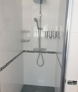 Large Shower Head with additional hand held Shower Head.