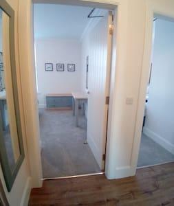 Access door to double bedroom.