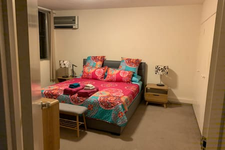 Spacious master bedroom with easy access