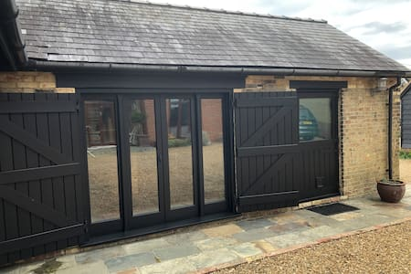 Two patio doors providing wide access as necessary, also have ramp should it be required.