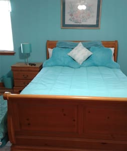 The bedroom is spacious with ample area all around the bed.