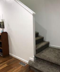 Ground Floor stairway to Upstairs Bedrooms, Bathroom, and Loft