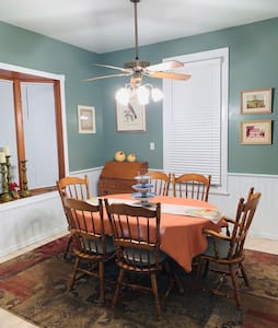 Step free dining room, with space around table by entrance. Connected to kitchen. They share an entry way.