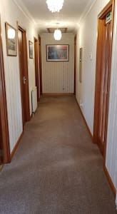 Hallway leading to the lounge , bathroom and bedrooms