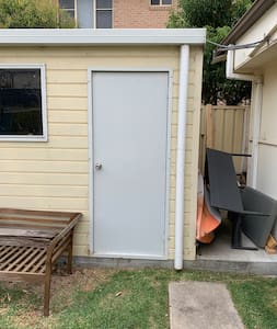 This is the entrance to the laundry. It is detached from the unit but right next to it.