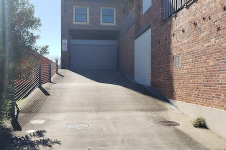 Ramp to second floor gated garage, remote control must be retrieved from the unit.