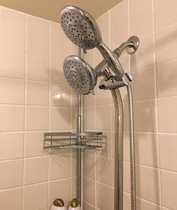 There is a hand held shower head.