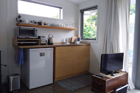 Compact kitchen. Would have difficulty opening the drawers with TV where it is. could move the TV but then it would be close to the couch.