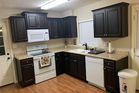 Fully functional kitchen, stove, microwave and fridge.