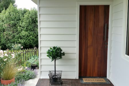 To get to this entrance door way there are two or three steps. Within the guest space there are no steps.