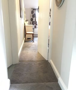 No step immediately in doorway but very shallow (8cm) step in landing on way to bedroom entrance.