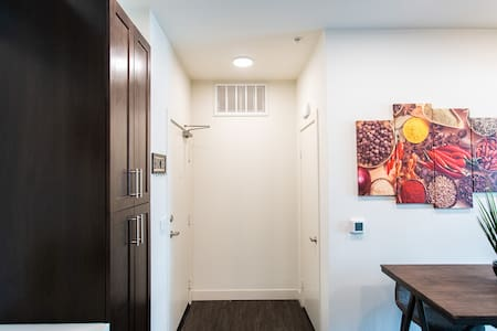 No stairs in entryway. The entry door is on the left.