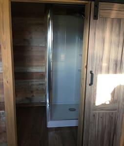 Sliding Barn doors open to access the bathroom.