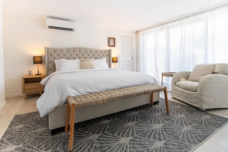 There is spacious room around the king size bed. There is one step to enter bedroom from outside and then no steps