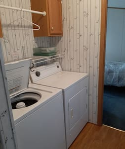 washing machine and dryer in hallway, between kitchen and master bedroom