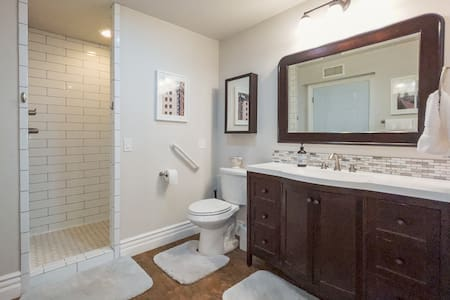 Grab bars by toilet and in the shower