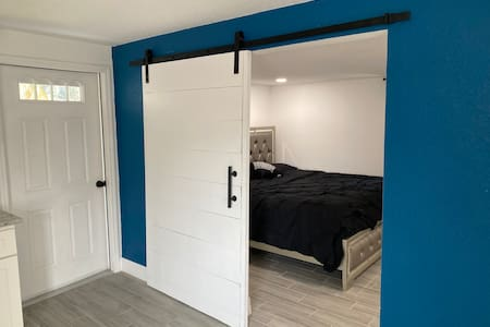 """Main room entrance door 42"""" wide sliding door."""