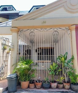 Gated garage entrance plus parking outside property