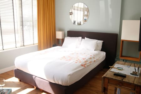The bed is ground floor, easy access from the studio main entrance.