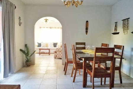 Kitchen dinning area. Large, bright with doors leading outside to the private pool.