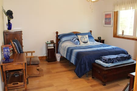 large bedroom has plenty of space that allows furniture to be moved to accommodate your needs