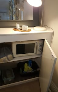 microwave on the right of the bed