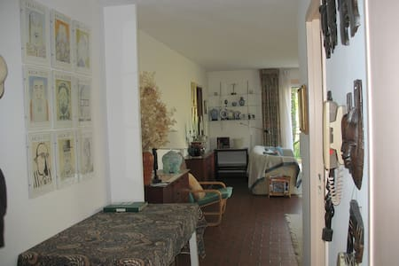 The view from the bedroom doorway to the living room - all wide doorways and spacious