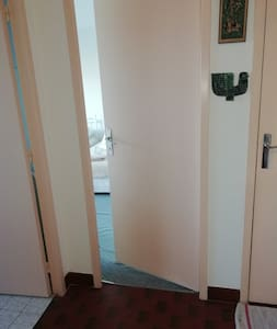 Inside the apartment, access is level  from the hall into the master bedroom (centre doorway)