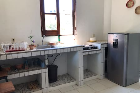 Kitchen that has been updated with microwave, coffee maker and blender