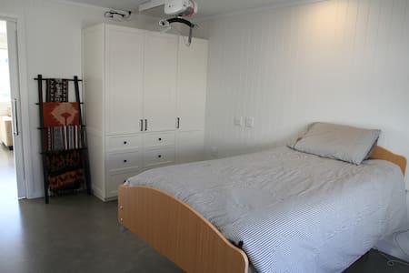 Bedroom floor is level with living area
