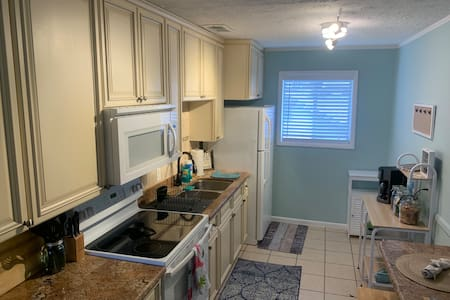 Gorgeous granite counter top kitchen with updated appliances stocked with everything you need to prepare that gourmet home cooked meal!