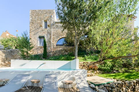 Enjoy the rustic charm of this stone house with pool and views