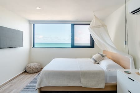 Live the Beach Life in a Boho Chic Apartment with Ocean View