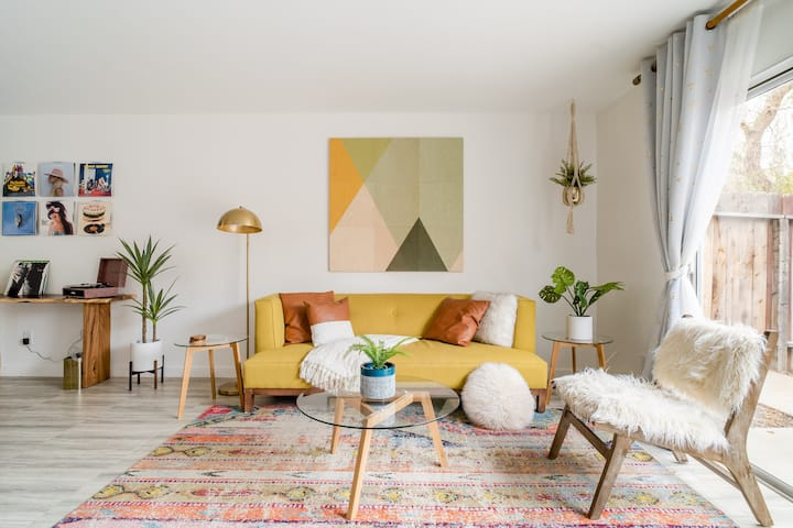 Spin Some Vinyl at a Lush Green Retreat with Pops of Color