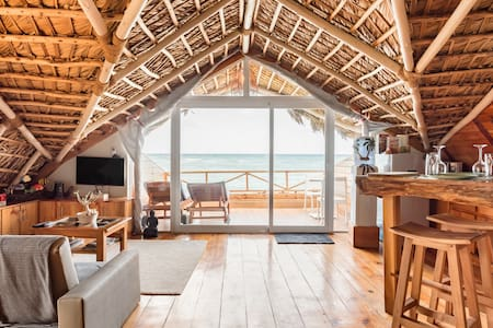 Rekindle a Romance in a Retro Thatched Hut on the Beach