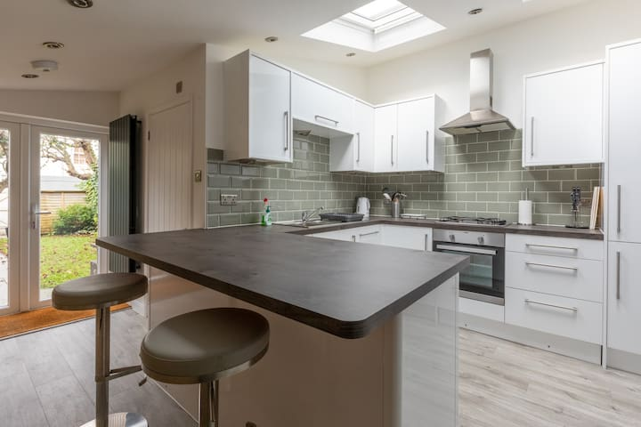 Light bright kitchen with French doors opening onto the west facing garden