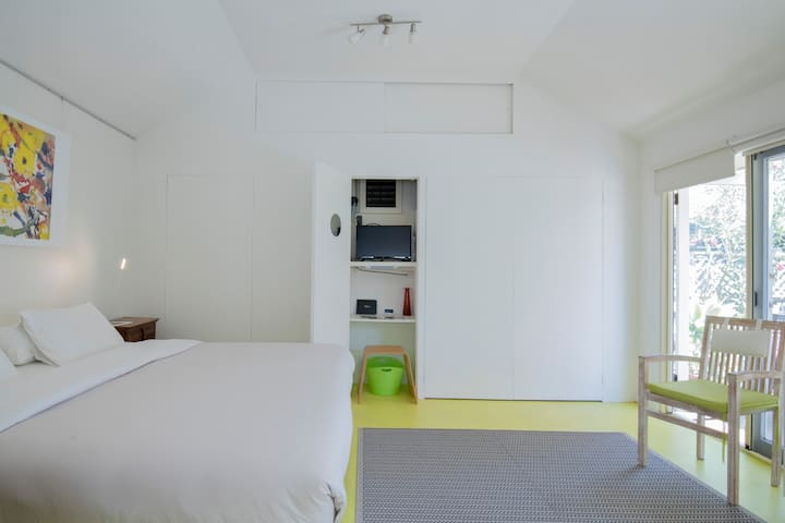 A wall of storage space discretely hidden behind high cupboards. TV is in centre cupboard (pictured).  Free wifi range extends to courtyard area.