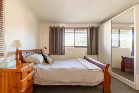 Spacious unit close to city, transport and airport