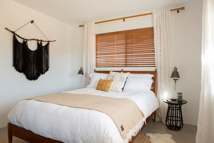 Bedroom 1 has panoramic south-facing views and is flooded with daytime sun.
