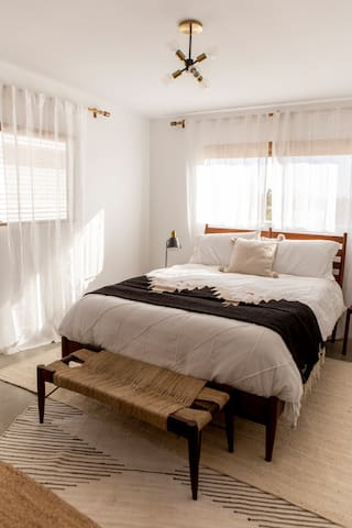 Bedroom 2 is outfitted with a Queen-size Tuft & Needle memory foam mattress.