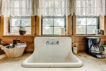Coffee supplies are provided for your stay. Enjoy the view from the salvaged farmhouse sink while your coffee brews.