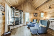 Cozy up in the comfortable armchairs next to the gas fireplace.