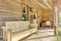 The front porch is a welcoming place to sit in either the antique metal glider or chair and take in the tranquil surroundings.